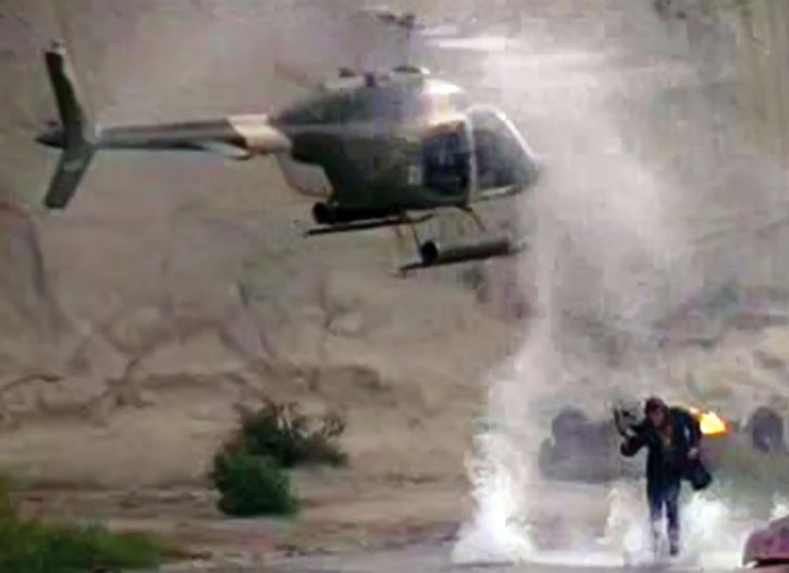 Mike Donovan (Marc Singer) runs from a helicopter