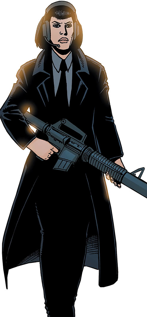 Miranda Zero of Global Frequency (Wildstorm Comics) with a silenced assault rifle and a headset
