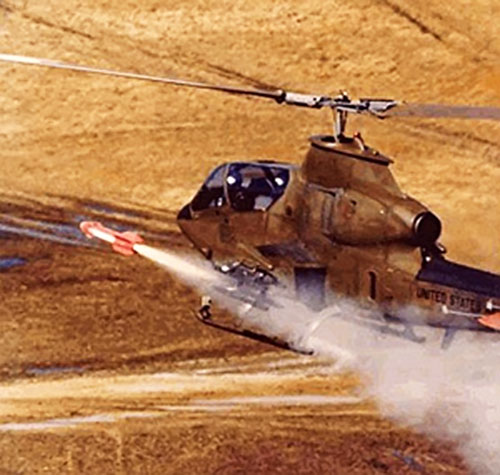 Helicopter gunship launching a missile