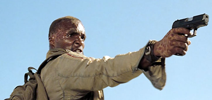 Mollaka aims his pistol