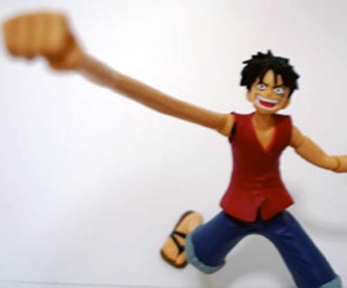 Monkey Luffy (One Piece) figurine with stretched arm