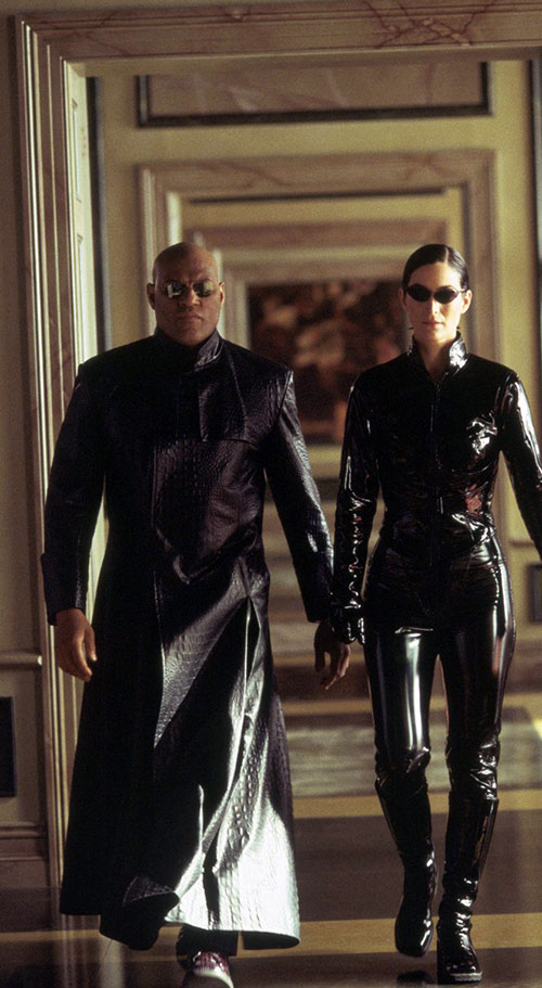 Morpheus (Laurence Fishburne) and Trinity walking down a corridor