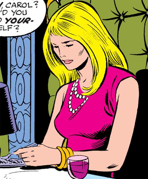 Carol Danvers (Marvel Comics) (Captain Marvel ally) in a pink dress at a dinner