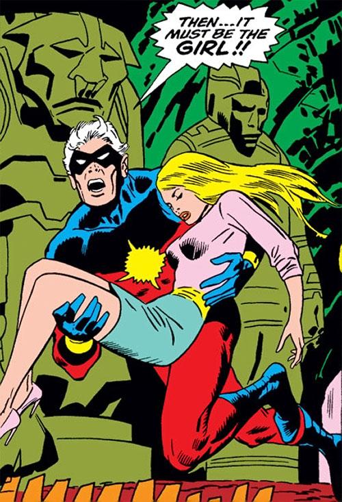 Captain Marvel comics (Mar-Vell) carrying a KO Carol Danvers