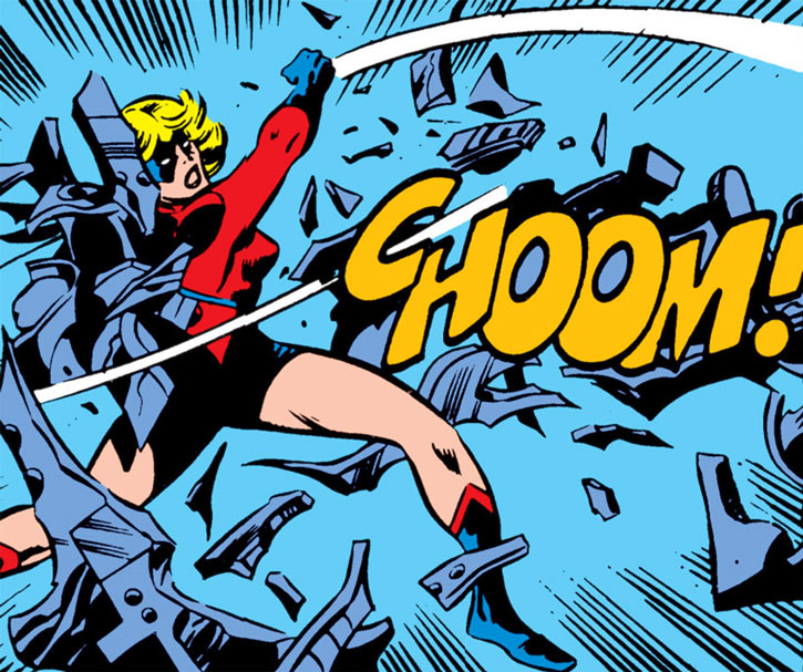 Ms. Marvel (Carol Danvers) punches through some machines