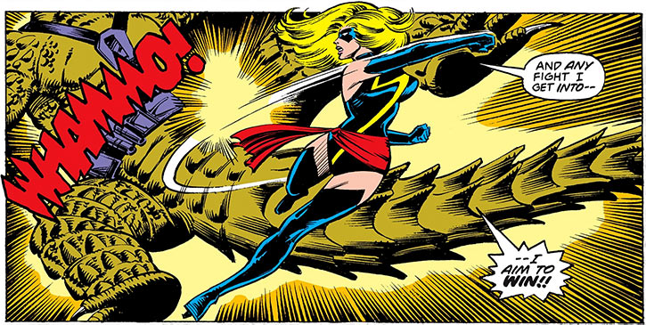 Ms. Marvel (Carol Danvers) (Marvel Comics) 1980s punching a lizard