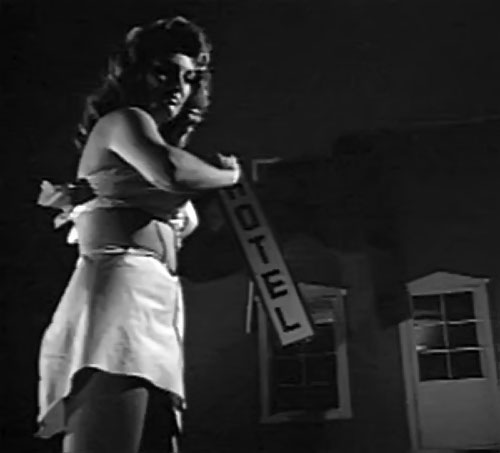 Nancy Archer (Allison Hayes in Attack of the 50 ft Woman) grabs an hotel sign