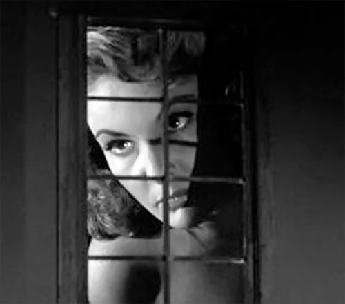 Nancy Archer (Allison Hayes in Attack of the 50 ft Woman) looking through a window
