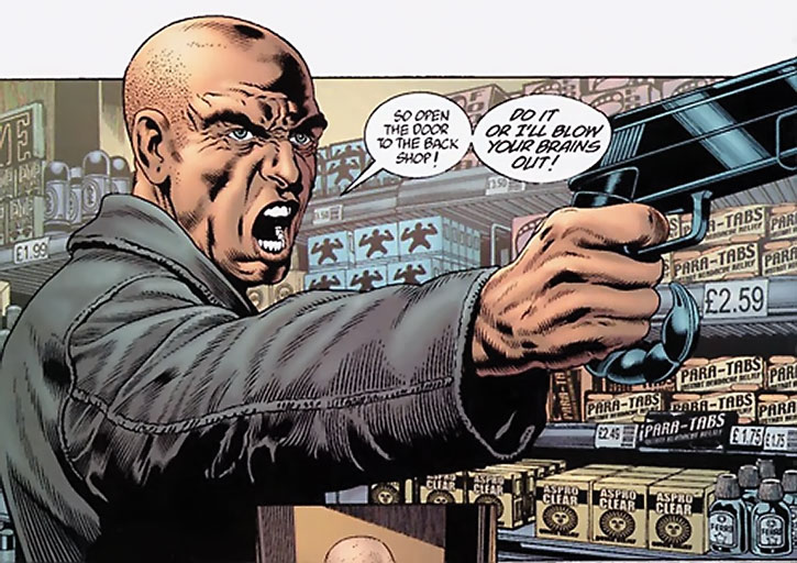 Ned Slade with a shaved head and his scorpion pistol