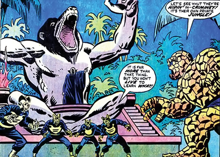 Black Spectre agents face the Thing under a mandrill statue