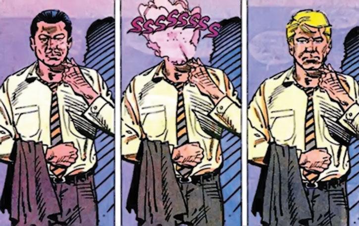 Nemesis (Thomas Tresser) undoes a mask
