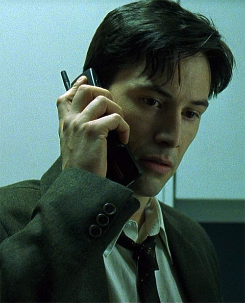 Neo (Keanu Reeves) as Thomas Anderson