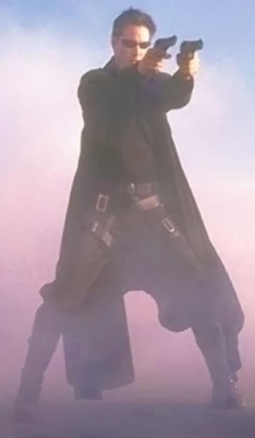 Neo (Keanu Reeves) dual-wields pistols