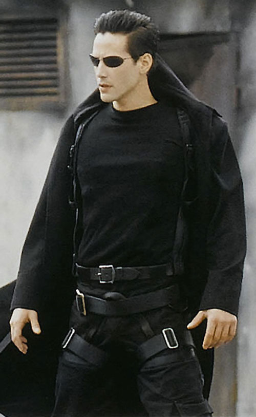 Neo (Keanu Reeves) is dressed to kill