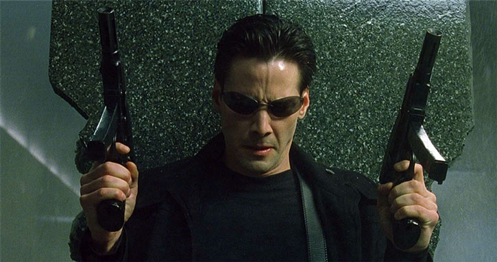 Neo (Keanu Reeves) dual-wields machine pistols
