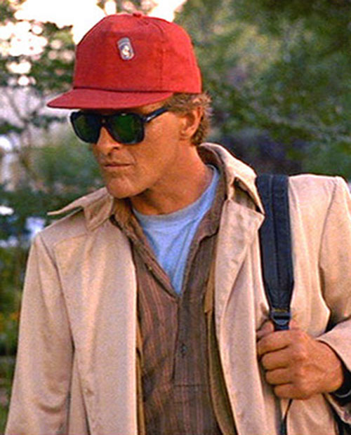 Nick Parker (Rutger Hauer in the movie Blind Fury) with a baseball hat and dark sunglasses