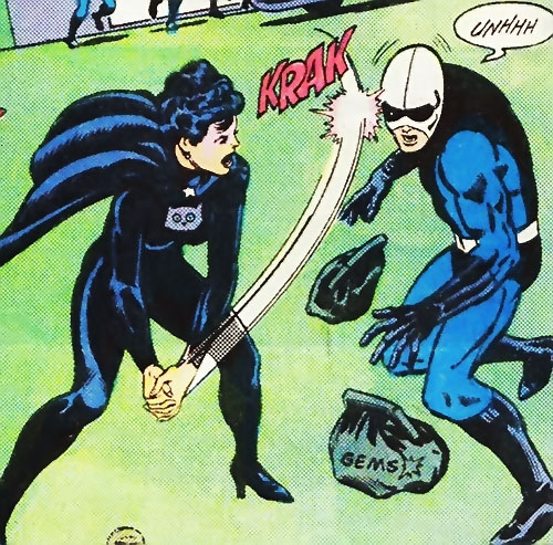 Night Girl of the Legion of Super-Heroes (DC Comics Silver Age) stops a robber