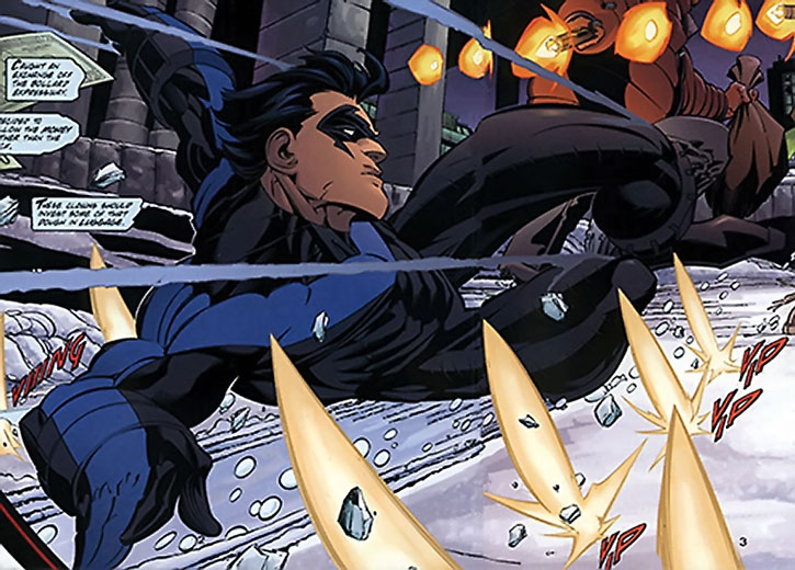 Nightwing (Dick Grayson) sliding in snow on the ground