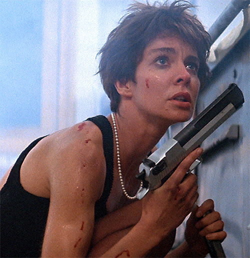 Nikita (Anne Parillaud) with a Desert Eagle during the kitchen shootout