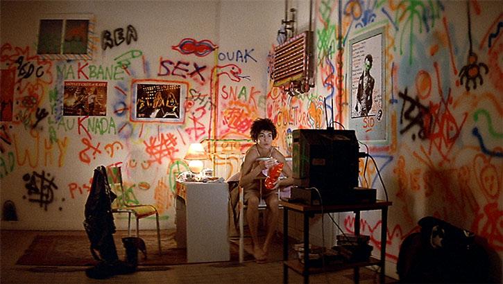 Nikita (Anne Parillaud) in a heavily tagged studio
