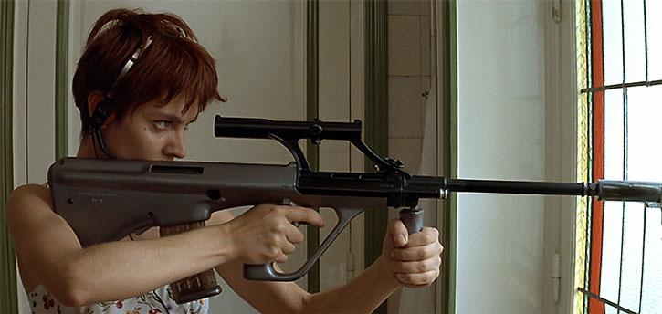 Nikita (Anne Parillaud) aims a Steyr assault rifle