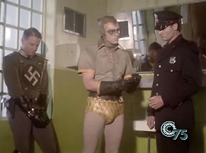 Nite-Owl arrests a Nazi super-villain during the 1940s