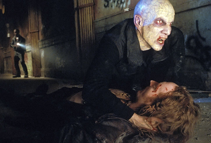 Nomake (Luke Goss) caught by a flashlight while feeding