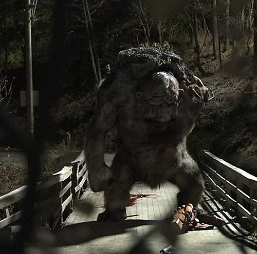 Trollhunter - Ringlefitch troll standing over a fallen human