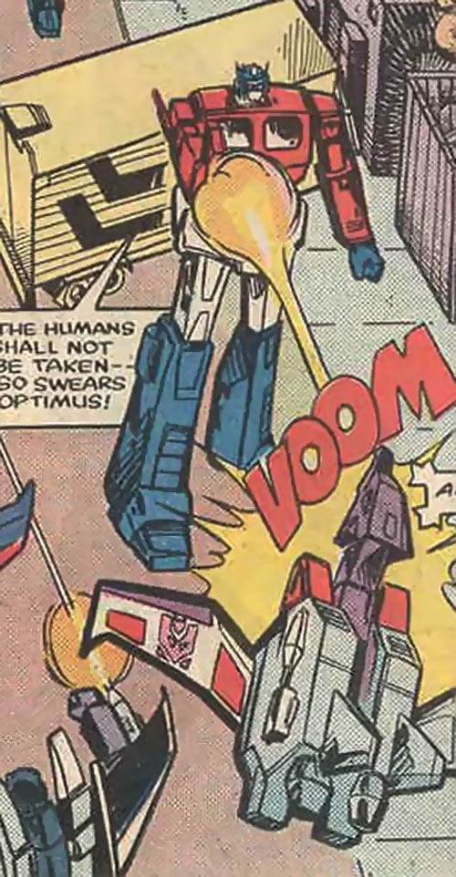 Optimus Prime of the Transformers in the G1 Marvel Comics shoots a flying Decepticon