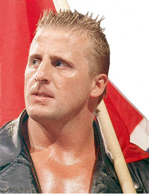 Owen Hart with a flag