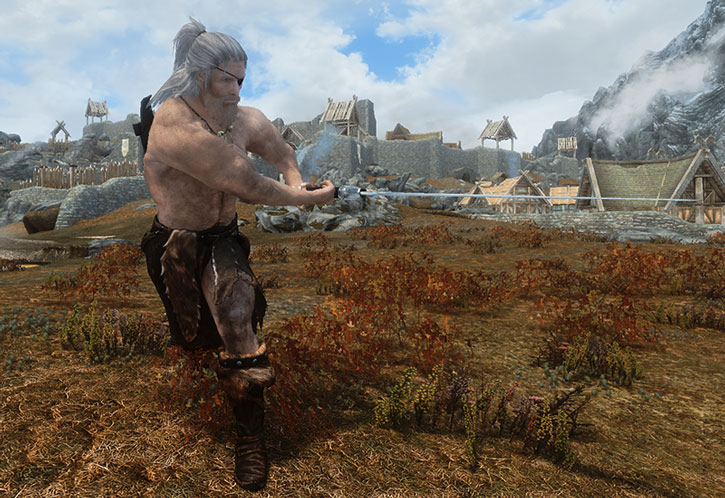 White-haired man with an eye patch swings a big sword