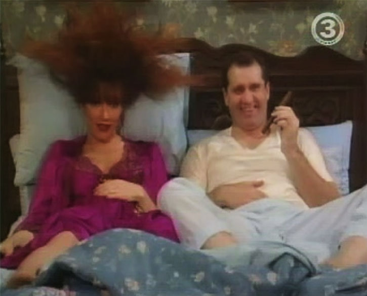 Peg Bundy (Katey Sagal) in bed with her husband