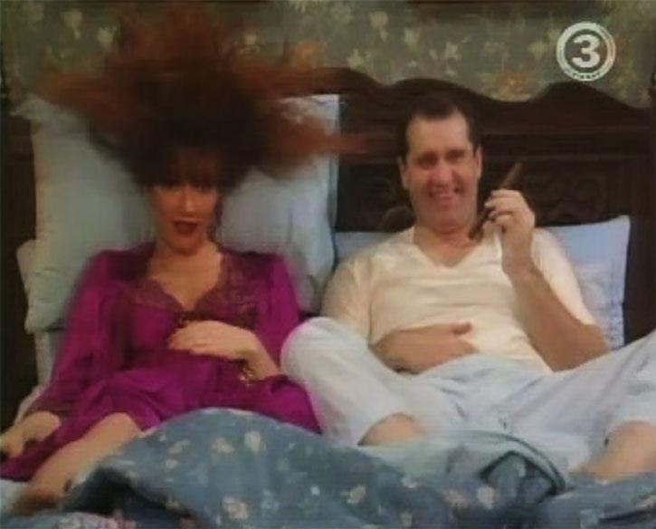 Peg Bundy (Katey Sagal) in bed with her husband