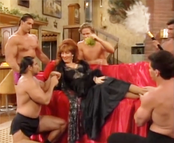 Peg Bundy (Katey Sagal) services by hunks in briefs