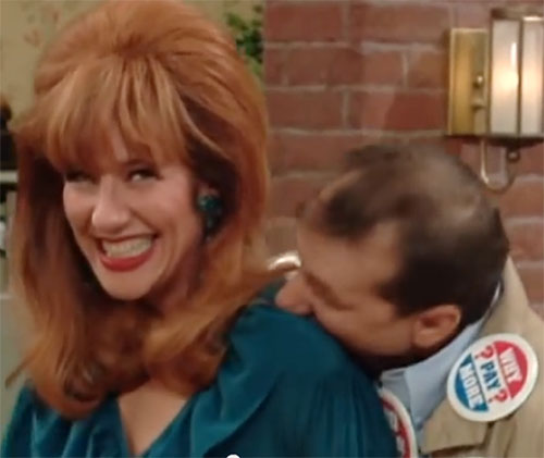 Peggy Bundy (Katey Sagal in Married With Children) shit-eating grin