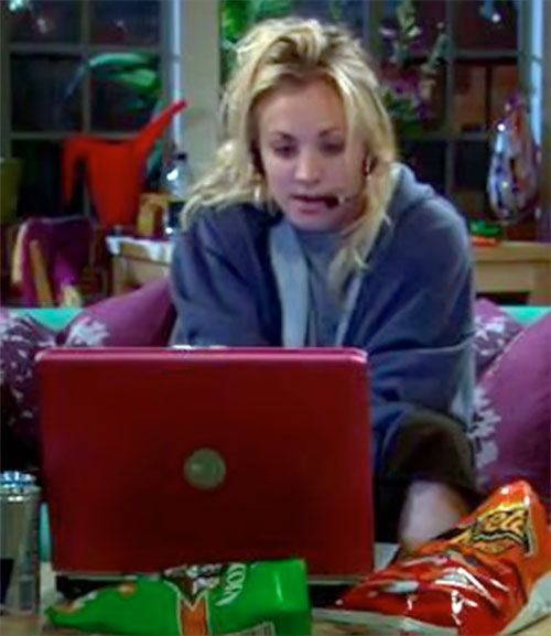 Penny (Kaley Cuoco in Big Bang Theory) playing on her laptop