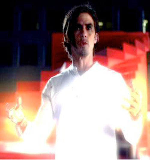 Peter Petrelli (Milo Ventimiglia in Heroes) in white with his hands glowing