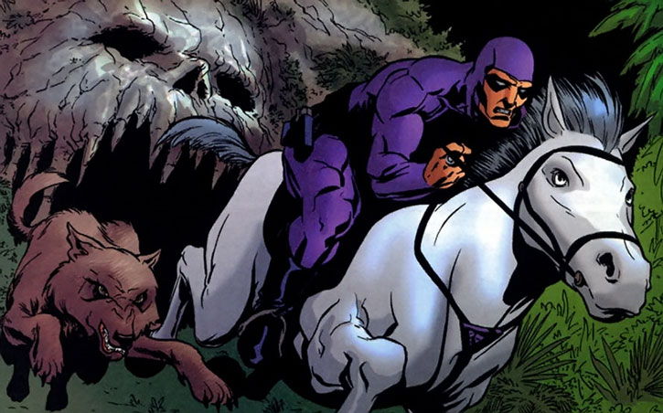 The Phantom with his horse and wolf gallops out of the skull cave