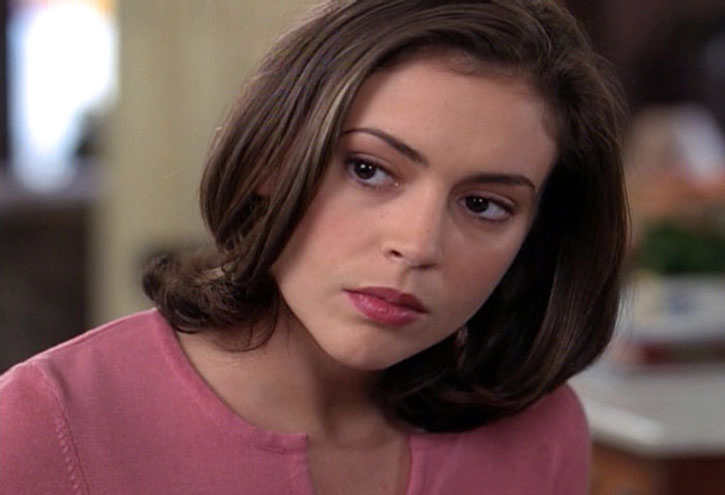 Phoebe Halliwell (Alyssa Milano) with her head cocked