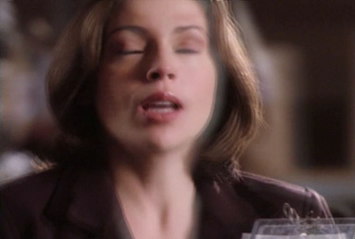 Phoebe Halliwell (Alyssa Milano) with eyes closed