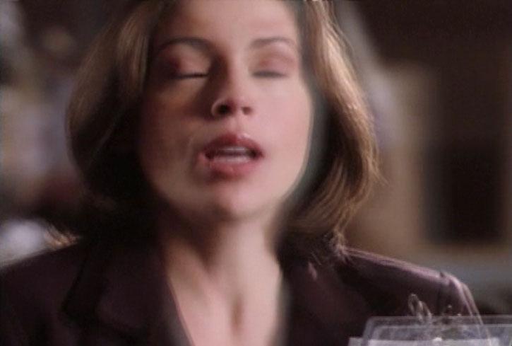 Phoebe Halliwell (Alyssa Milano) with eyes closed