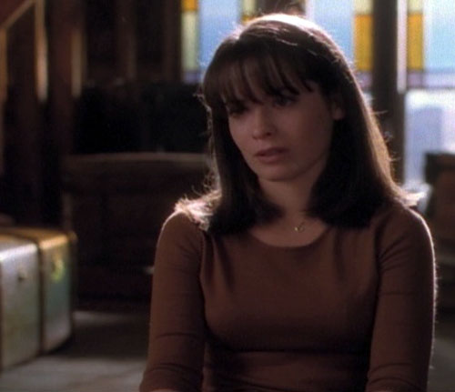 Piper Halliwell (Holy Marie Combs in Charmed) in a dark-ish room