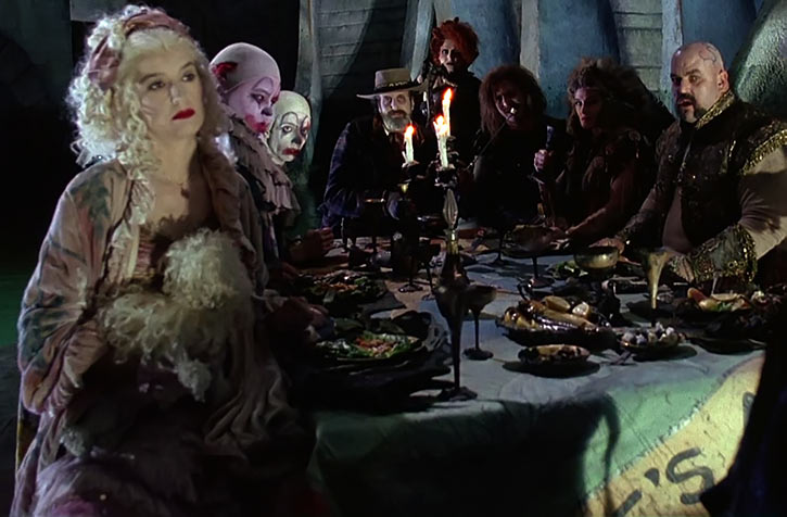 Poodle Lady (Batman Returns 1992 movie) dining with the Red Triangle Gang