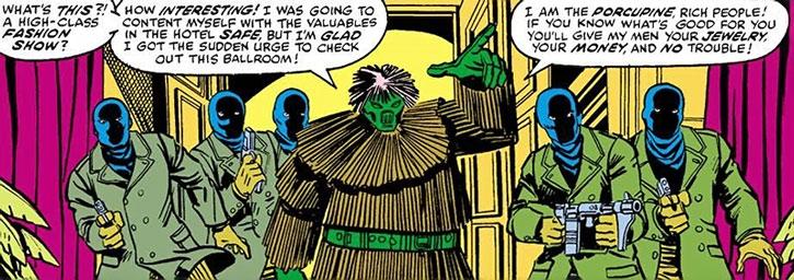 Porcupine (Alexander Gentry) and henchmen robbing a fashion show