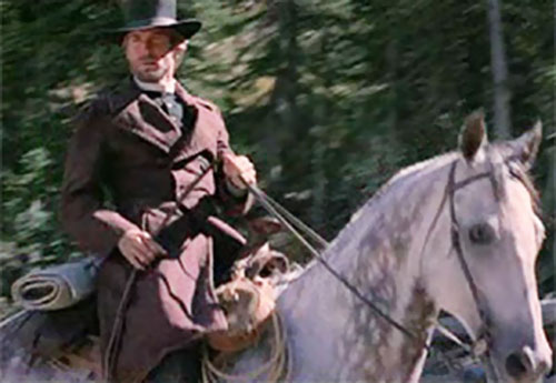The preacher (Clint Eastwood in Pale Rider) riding in a forest