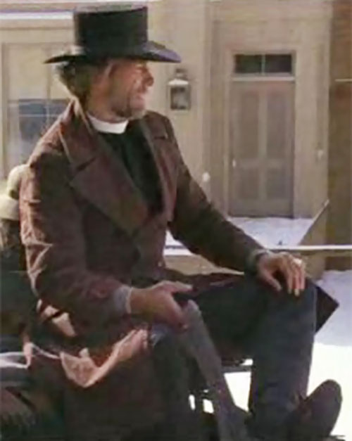 The preacher (Clint Eastwood in Pale Rider) operating a carriage