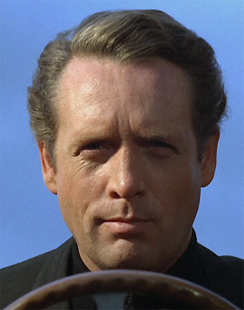 Number Six (Patrick McGoohan in The Prisoner) behind the wheel