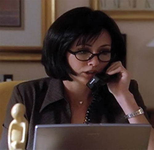 Prue Halliwell (Shannen Doherty in Charmed) on the phone