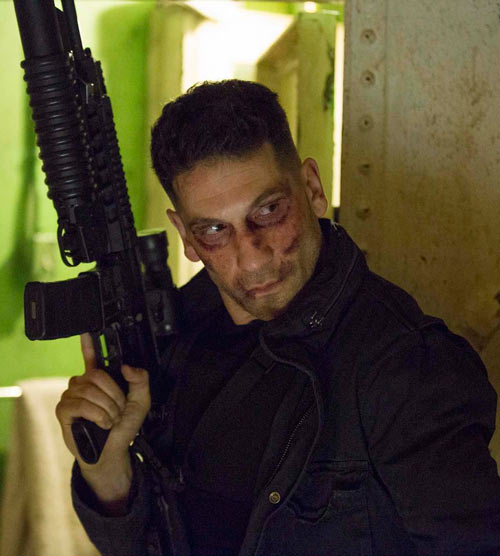 Punisher (Jon Bernthal in Netflix's Daredevil season #2) battered with raised assault carbine