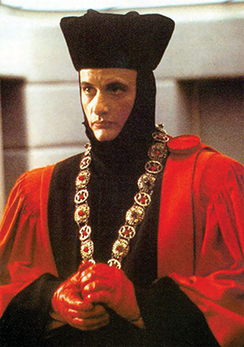 Q (John de Lancie in Star Trek) in a red and black costume